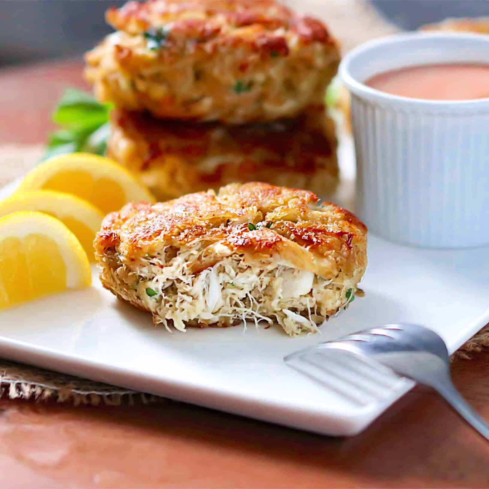 Crab Cakes with lemon wedges