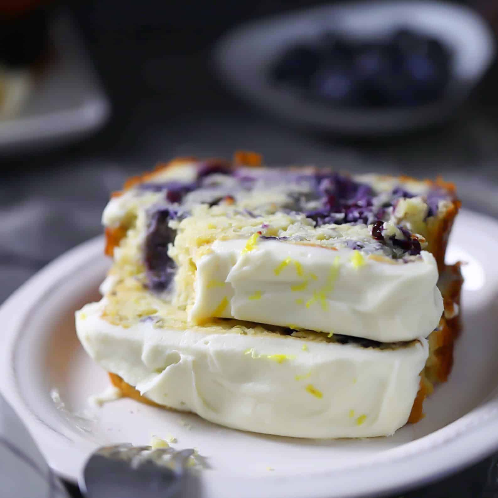 Low-Carb, Keto Lemon Blueberry Bread Loaf Slices with lemon icing