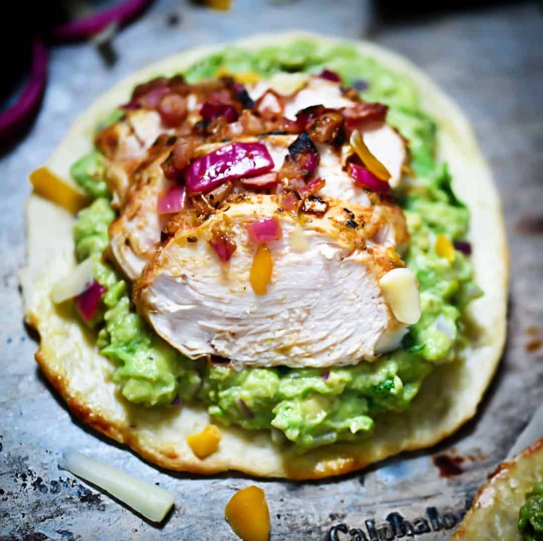 Grain-Free Chicken Tostadas on guacamole with cheese