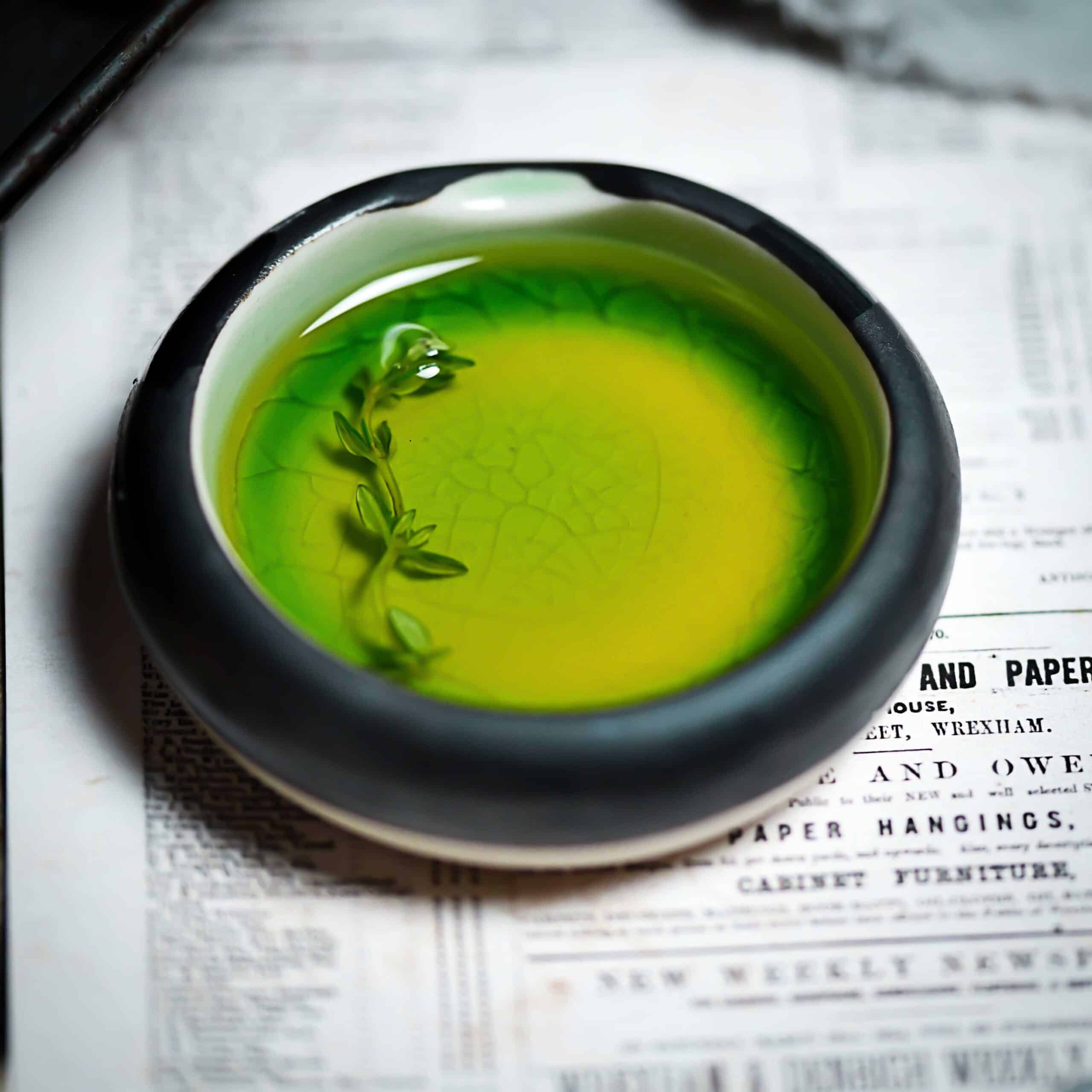Olive Oil With Thyme in Green Dish